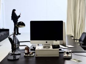 modern workspace with computer and instant photo camera